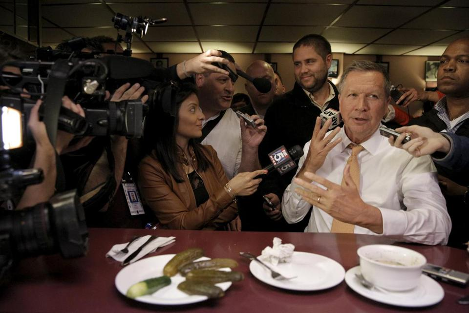 Republican presidential candidate John Kasich spoke to reporters at PJ Bernstein's Deli Restaurant in New York City on Saturday.